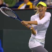 Clinical: Maria Sharapova plays a shot from Italy's Francesca Schiavone in their second-round match at the BNP Paribas Open on Friday. Sharapova won 6-2, 6-1. | AP