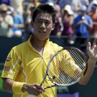 Miami vice: Kei Nishikori waves after beating Xavier Malisse 6-2, 7-5 in the third round of the Sony Open on Sunday in Key Biscayne, Florida. | AP