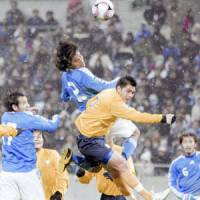 Japan defender Yuji Nakazawa heads in a goal in the 66th minute during the Asian Group Two tournament for the 2010 World Cup against Thailand on Wednesday at Saitama Stadium 2002. Japan won 4-1. | KYODO PHOTO