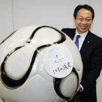 Having a ball: National team manager Takeshi Okada believes his team has grown with each game over the past year. | KYODO PHOTO