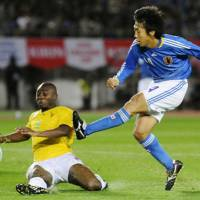 Big victory: Japan midfielder Kengo Nakamura shoots during the first half of Wednesday's international friendly against Togo at Miyagi Stadium. Japan won 5-0, scoring three goals in the first 11 minutes. | KYODO PHOTO