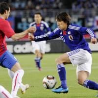 Not according to plan: Shunsuke Nakamura attempts to move the ball around a Serbian player during Japan's international friendly against Serbia on Wednesday at Nagai Stadium. Serbia won the match 3-0. | KYODO PHOTO