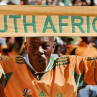 Festive atmosphere: Fans revel in the excitement of the 2010 World Cup's opening ceremony on Friday in Johannesburg.   KYODO PHOTOS