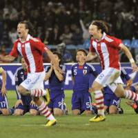 Close call: Paraguay team members celebrate their fifth successful penalty kick against Japan, which knocked Samurai Blue out of the World Cup. | KYODO PHOTO