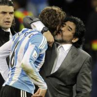 End of the road?: Diego Maradona consoles Gabriel Heinze after Saturday's 4-0 loss to Germany. It is uncertain whether Maradona will remain Argentina's manager. | AP PHOTO
