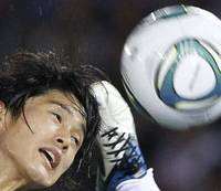Case for the defense: Atsuto Uchida heads the ball during Japan's 0-0 draw with the Czech Republic in Yokohama on Tuesday night. | AP