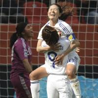 Showing the way: Homare Sawa celebrates with teammate Nahomi Kawasumi after scoring against Mexico in their Women's World Cup Group B match on Friday. Japan won 4-0. | AP PHOTO
