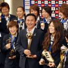 'Nadeshiko' Japan feted upon return