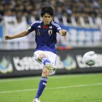 Celebration time: Japan's players show their excitement after Maya Yoshida's injury-time goal against North Korea on Friday in the teams' first World Cup qualifier in Saitama. Japan beat North Korea 1-0. | KYODO PHOTOS