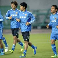 Full strength: Shinji Kagawa (center) and Yuto Nagatomo (right) take part in a training session ahead of Japan's friendly against Vietnam in Kobe on Friday. | KYODO PHOTO