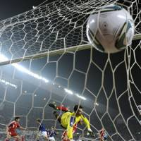 As easy as it gets: Japan scores early and often in its 8-0 win over Tajikistan in a World Cup qualifier on Tuesday in Osaka. | KYODO