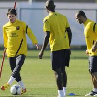 Straight to work: Lionel Messi (left) trains with his Barcelona teammates in Yokohama on Monday. | KYODO PHOTO