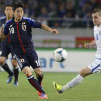 Fine-tuning: Shinji Kagawa (left) vies for the ball during Japan's 2-0 win over Azerbaijan on Wednesday. | KYODO