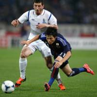 Rising sun: Arsenal forward Ryo Miyaichi made his international debut against Azerbaijan on Wednesday and has been retained for Japan's upcoming World Cup qualifying series. | AP