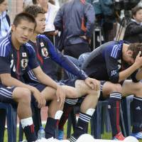 Work in progress: Japanese players sit on the bench during their 3-2 loss to Egypt on Sunday in Le Lavandou, France. | KYODO