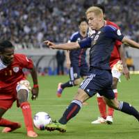 The catalyst: Japan's Keisuke Honda scores an 11th-minute goal against Oman in Sunday's World Cup qualifier at Saitama Stadium. Japan defeated Oman 3-0. | KYODO