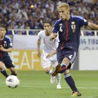 Banner night: Japan's Keisuke Honda scores on a 53rd-minute penalty against Jordan on Friday in a 2014 World Cup qualifier at Saitama Stadium. Honda had three goals in Japan's 6-0 victory. | KYODO PHOTOS