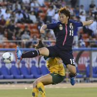 Ready for the world: Megumi Takase kicks the ball during Nadeshiko Japan's 3-0 win over Australia on Wednesday. | KYODO