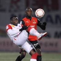 Going for it: Rennes' Kevin Catherine (left) vies for the ball with Nancy's Simon Zenke in French League action on Friday night. Rennes won 3-1. | AP