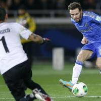 Setting the tone: Juan Mata scores Chelsea's opening goal in the first half against Monterrey at Nissan Stadium. Chelsea won 3-1. | KYODO