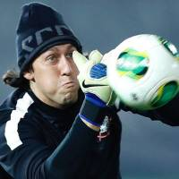 Getting ready: Corinthians goalkeeper Cassio practices during a training session on Saturday, a day before the Club World Cup final in Yokohama. | AP