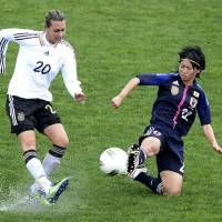 Beaten again: Yoko Tanaka tackles Germany's Lena Groessling during their Algarve Cup match on Friday in Parchal, Portugal. Germany defeated Nadeshiko Japan 2-1. | AFP-JIJI