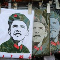 China's challenge: T-shirts depicting a Communist Party-styled image of U.S. President Barack Obama are seen on sale at a Beijing shop in May. | AFP-JIJI