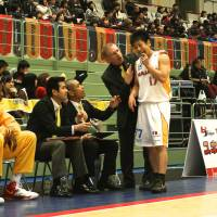 Disappointing season: Despite their struggles, Sendai 89ers guard Hikaru Kusaka, seen talking to former coach Bob Pierce along with team interpreter Torahiko Enda (second from left) and general manager/current acting head coach Takeo Mabashi, and his teammates continue to be a symbol of inspiration in Miyagi Prefecture. The team was actively involved in relief efforts immediately following the Great East Japan Earthquake and tsunami in March 2011.  | KAZ NAGATSUKA