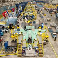 Defense strategy: A Lockheed Martin plant in Fort Worth, Texas, where an F-35 is under production. Lockheed Martin has spread work on the fighter jet across 45 states, which in turn has generated broad bipartisan support on Capitol Hill. | THE WASHINGTON POST