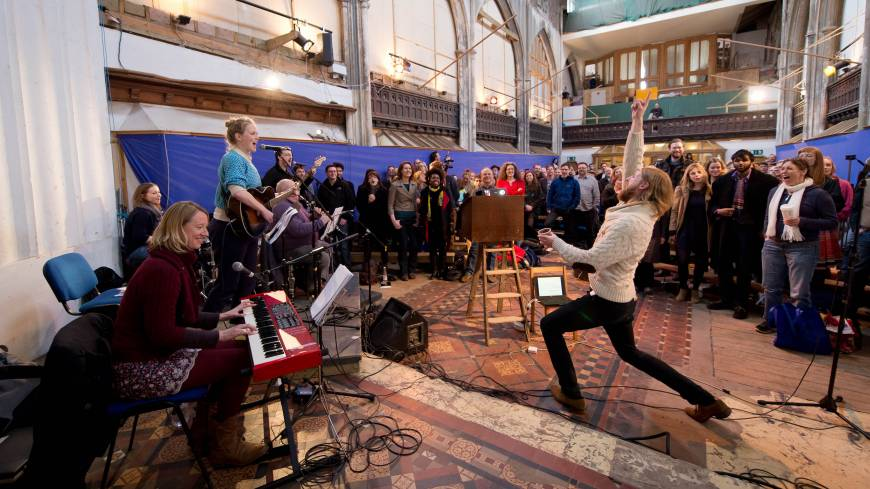 Alternative service: British comedians Sanderson Jones (right) and Pippa Evans (second from left), cofounders of The Sunday Assembly, an atheist church in north London, lead their congregation in song March 3.