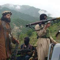 No place like home: Taliban militants patrol their stronghold of Shawal, in Pakistan's South Waziristan tribal region, last August. | AP