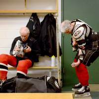 Hit the ice: Clark Torell (left) and Iver Mindel get dressed for a weekly hockey game at The Gardens Ice House in Laurel, Maryland. Every week the group of men, all mostly over the age of 70, get together for a friendly game of hockey in the Gerihatricks league. | THE WASHINGTON POST