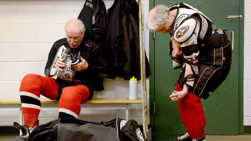 Hit the ice: Clark Torell (left) and Iver Mindel get dressed for a weekly hockey game at The Gardens Ice House in Laurel, Maryland. Every week the group of men, all mostly over the age of 70, get together for a friendly game of hockey in the Gerihatricks league.