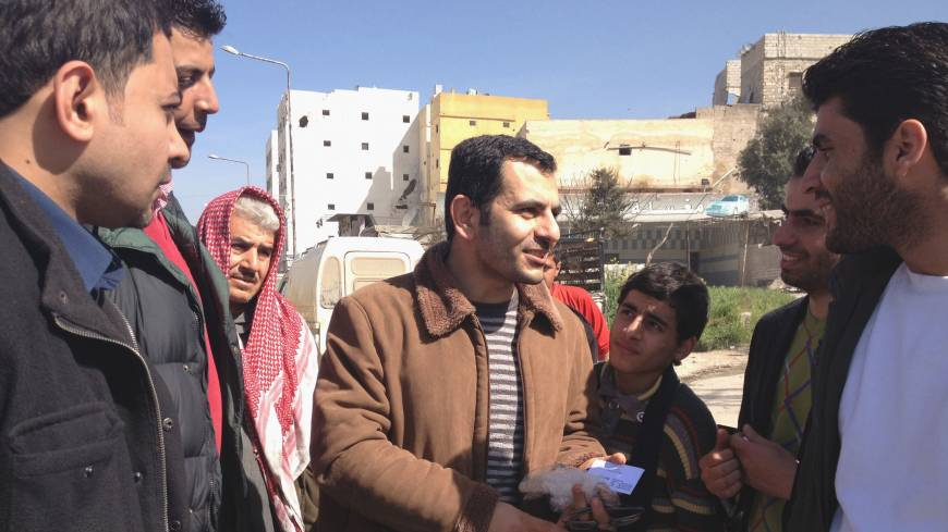Outside the 'law': Supporters greet Dr. Othman al-Haj Othman on March 14 in Aleppo, Syria, after his release from the headquarters of a new authority that is trying to assert Islamic law. Othman was detained for taking down a poster bearing the Muslim declaration of faith. Left: Activist Wael Ibrahim, 30, was sentenced to 10 lashes with a small pipe last month for tossing aside an Islamic banner at a protest.