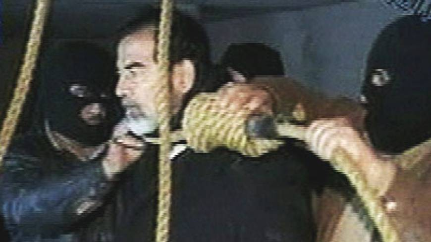 Saddam Hussein's guards place a noose around the deposed strongman's neck moments before his execution on Dec. 30, 2006, in the Iraqi capital.