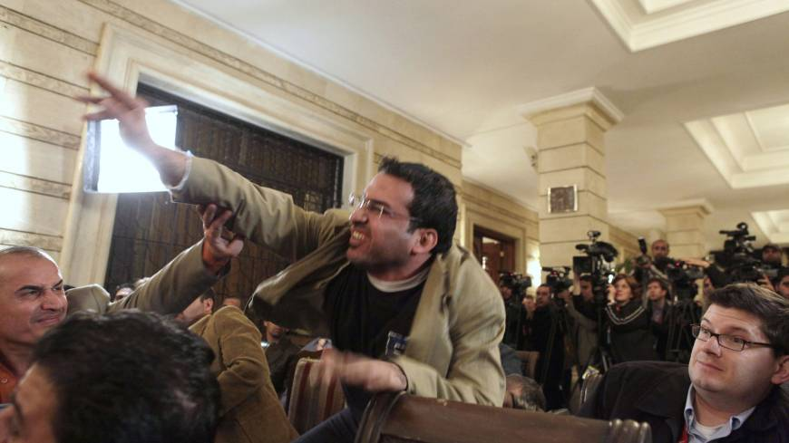 Iraqi journalist Muntadhar al-Zeidi throws a shoe at Bush in Baghdad in December 2008.