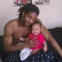 Lost: Jonathan Watkins, 29, holds his 6-month-old daughter, Jonylah, in Chicago. The infant died March 12 after a gunman approached their minivan and shot them the night before while she was in her father's lap. Watkins was severely injured. | AP