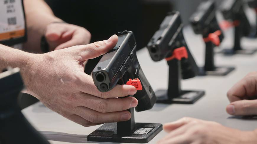 Trigger happy: Gun enthusiasts inspect Glock pistols at a gun show in Las Vegas on Jan. 16.