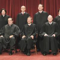 Top tribunal: U.S. Supreme Court justices gather for a group portrait in Washington in October 2010. Seated from left are Associate Justices Clarence Thomas and Antonin Scalia, Chief Justice John Roberts, Associate Justices Anthony Kennedy and Ruth Bader Ginsburg. Standing, from left, are Associate Justices Sonia Sotomayor, Stephen Breyer, Samuel Alito and Elena Kagan. | AP