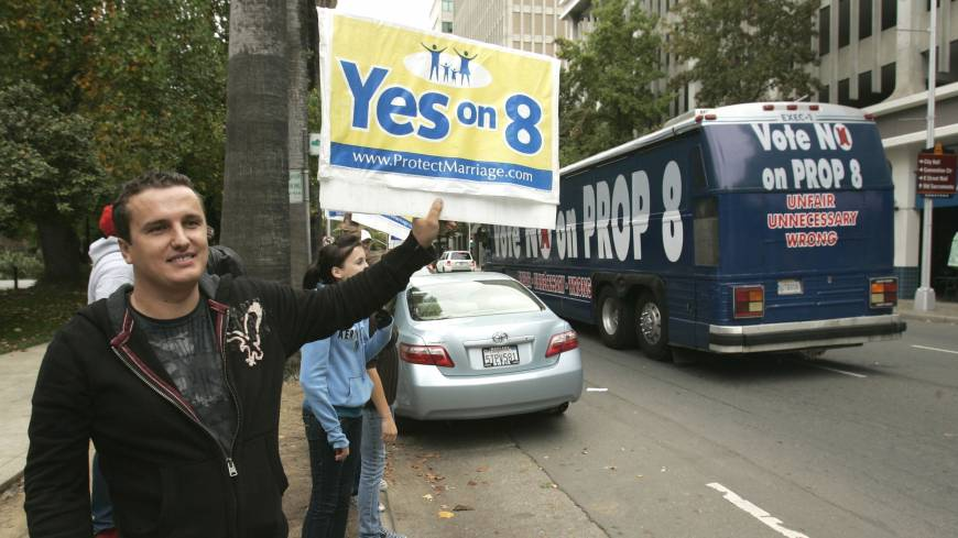 Courting voters: A man holds up a 'Yes on 8' sign as a bus passes, bearing another sign to 'Vote No On Prop 8,' in Sacramento, California, in November 2008. The Supreme Court can choose from a wide array of outcomes in ruling on California's Proposition 8 ban on same-sex marriage and the federal Defense of Marriage Act (DOMA), which defines marriage as the union of a man and a woman. The cases will be argued Tuesday and Wednesday; rulings are not likely before late June.