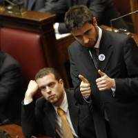 Double trouble: Five Star Movement party lawmaker Alessandro di Battista (right) attends a Parliament session to elect the lower chamber's president in Rome on March 16. | AP
