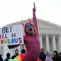 Swing vote: A gay supporter dances in front of the U.S. Supreme Court in Washington on Tuesday. | AFP-JIJI