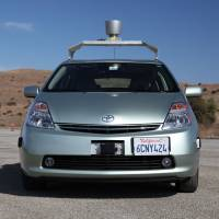 Hands-free: Google driverless cars navigate using video cameras, radar sensors, a laser range finder and maps. An override system allows a human driver to take control of the car by turning the steering wheel or pressing the brake. | BLOOMBERG