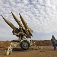 Ballistic threat: Iranian Army personnel prepare to launch missiles during a maneuver at an undisclosed location in the country last Nov. 13. | AP