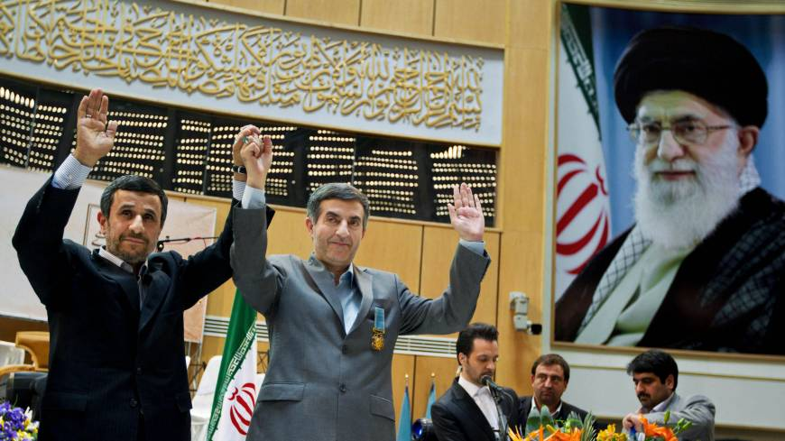 'Long Live Spring': Iranian President Mahmoud Ahmadinejad (left) and Chief of Staff Esfandiari Rahim Mashaei hold hands at a news conference in Tehran on March 10.