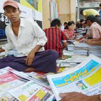 Read all about it: Newsstands in Yangon on Monday reported an early morning rush by readers eager to participate in the latest political reforms in the country. | KYODO