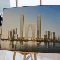 Of grave concern: An illustration of a real estate development is displayed in Suzhou, China, in 2011. The country is mulling sea burials as its breakneck growth has sent grave prices rocketing. | BLOOMBERG