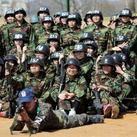 Young guns: South Korean high school students attend a two-day training camp to experience army life at a military base in Gwangju, south of Seoul, on  Tuesday. | AFP-JIJI