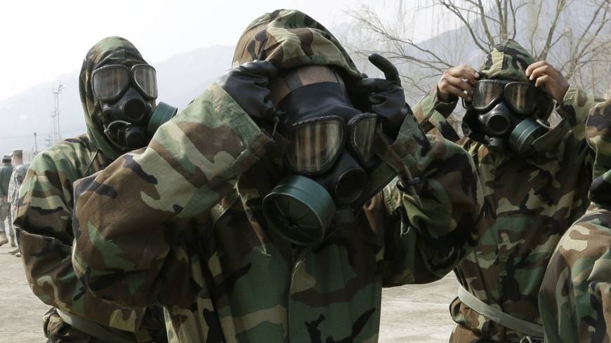 Gearing up: U.S. Army 23rd chemical battalion members check their gas masks in Uijeongbu, north of Seoul, on April 4.