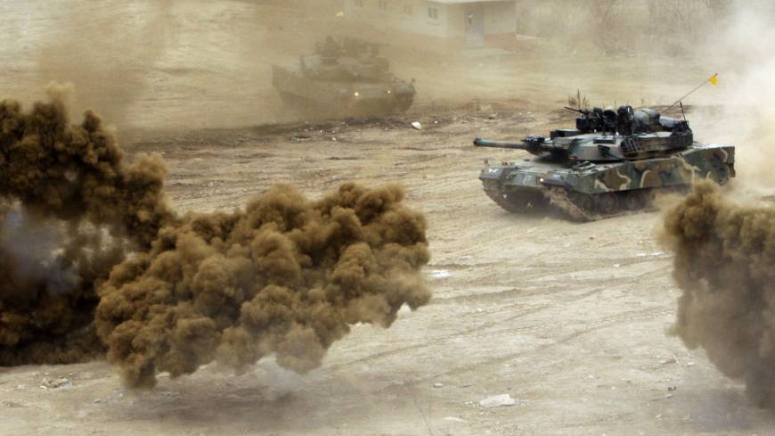 Smoke bombs explode near South Korean Army tanks in an exercise near the demilitarized zone last week.